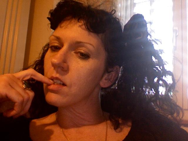 She_chews_on_finger_51708